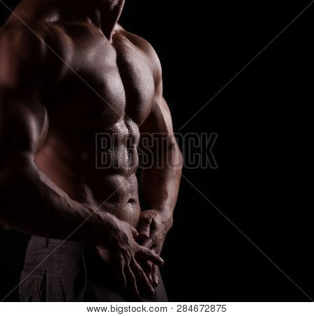 Strong Athletic Man Torso Isolated On Black Background