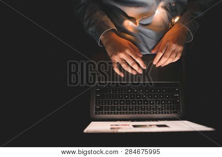 Woman Uses A Laptop At Night In The Bed, A View From Above. Use The Internet In Bed On A Laptop. Gir