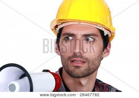 A disturbed tradesman holding a megaphone