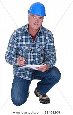 Builder writing on a piece of paper