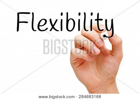 Hand Writing The Word Flexibility With Black Marker On Transparent Wipe Board. Concept About Adaptab