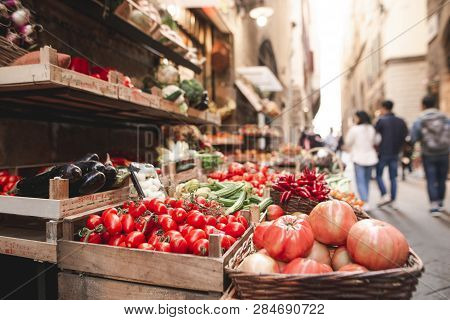 Many Different Fresh Vegetables Are Sold On The Streets Of A Tourist Town. Street Market With Vegeta