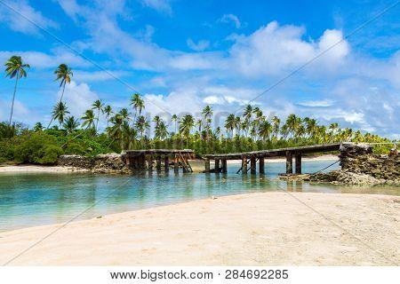 Broken Bridge Under Palm Trees Between Islets Over Lagoon, North Tarawa Atoll, Kiribati, Micronesia,