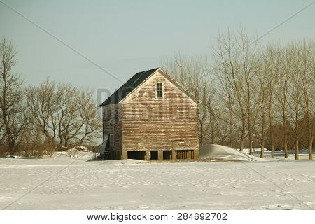 An Old Granary Used For Storing Different Grain Crops. Note The  Foundation Is Made Of Four Cement W