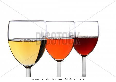 Three different glasses filled with dfferent wines. Chardonnay, White Zinfandel, and Cabernet Sauvignon wines in three overlapping wine glasses. (NOTE)replaces deleted image.