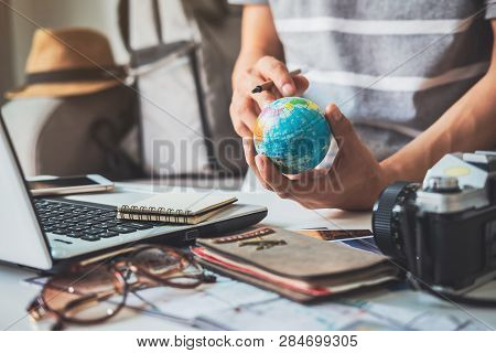 Young Traveler Planning Vacation Trip And Searching Information Or Booking Hotel On Laptop, Travel C