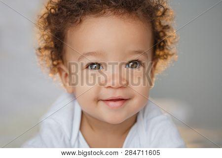 Cute baby with fluffy hair. Pretty boy.