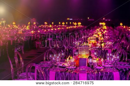 Pink And Purple Christmas Decor With Candles And Lamps For A Large Party Or Gala Dinner