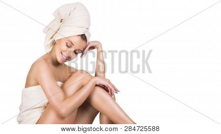 Woman Tacking Care Of Her Legs Sitting On White Background. Skin Acre Concept.