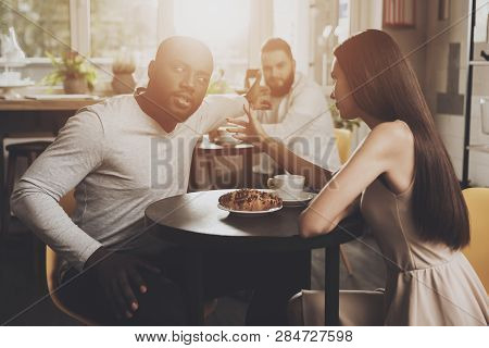 Young Couple Men And Women Find Out The Relationship. Young African American Man And Beautiful Girl