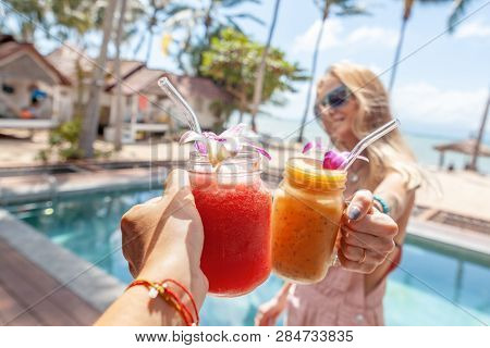 Beautiful With Tropical Cocktails Cheers Woman. Celebration Party. Summer Beach Concept. Nature Conc
