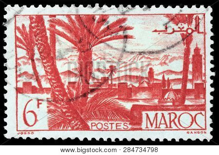 Luga, Russia - January 24, 2019: A Stamp Printed By Morocco Shows View Of Marrakesh - A Major City O