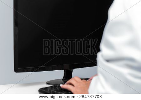 Doctor Sitting On The Computer, Monitor With Copyspace, Concept Telemedicine And Telehealth, Closeup