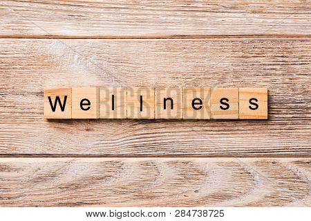 Wellness Word Written On Wood Block. Wellness Text On Wooden Table For Your Desing, Concept