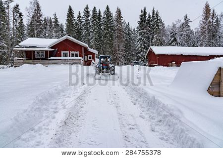 Old Blue Fordson Dexta Tractor Plowing Snow