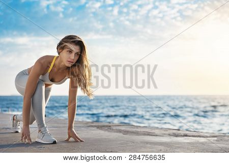 Motivated Attractive Fit Sporty Caucasian Sportswoman Low Start Pose Looking Forward Jogging, Runnin