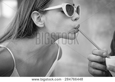 Thirsty for a drink. Cute woman drink through straw. Pretty woman sip beverage with drinking straw. Fashionable woman enjoy sipping drink through straw. poster