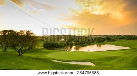 Panoramic view of water hazards on a fairway golf course poster