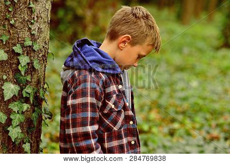 Helpless And Timid. Small Orphan. Small Kid Is Orphan. Cute Kid Alone In Woods. Late Child Is Early
