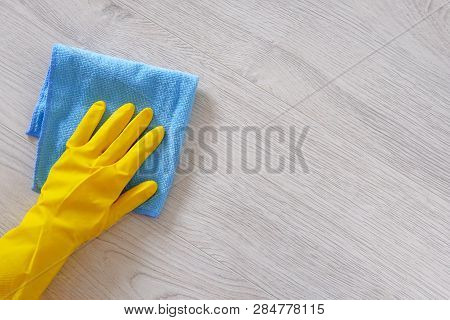 Commercial Cleaning Company Concept. Hand In Rubber Protective Glove With Blue Microfiber Cloth Is W