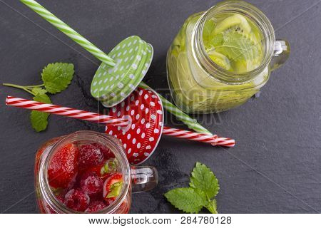 Fresh Cold Water With Lemon, Lime And Carambola And With Strawberries And Raspberries