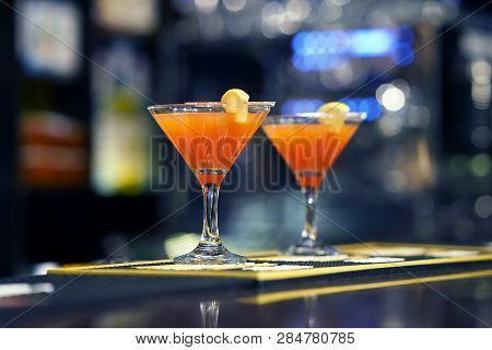 Fresh Red Cocktail With Grapefruit. Alcoholic, Non-alcoholic Drink-beverage At The Bar Counter In Th