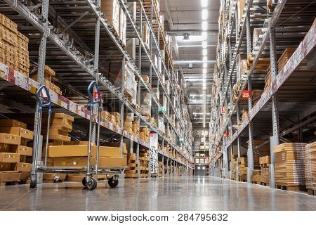 Goods Shelves Of Warehouse Handling Management, Products Storehouse Interior And Distributor Shoppin