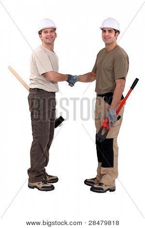 Tradesmen shaking hands