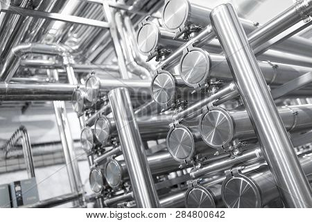 Steel Water Pipeline, Chrome Pipes, Pipe Lines In Plant Workshop. Industrial Background