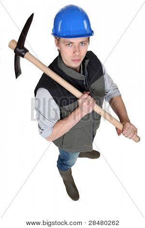 Tradesman holding a pickaxe poster