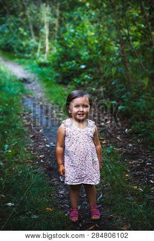 Little Girl Walking In The Park Little Girl