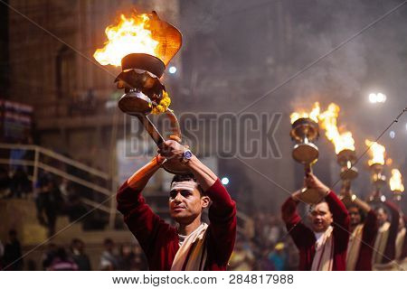 Varanasi, India- 23 January 2017 : A Hindu Priest Performs The Ganga Aarti Ritual In Varanasi