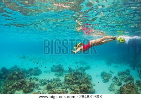 Young Happy Girl In Snorkeling Mask Jump And Dive Underwater To See Tropical Fishes In Coral Reef Se