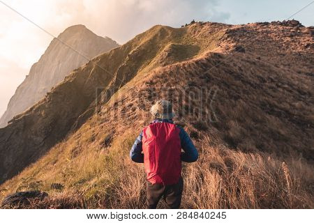 Young Man Traveler With Backpack Trekking On Mountain, Adventure Travel Lifestyle Concept