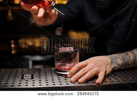 Professional Bartender Adding A Bitter To The Delicious Cocktail From The Special Dasher Bottle On T