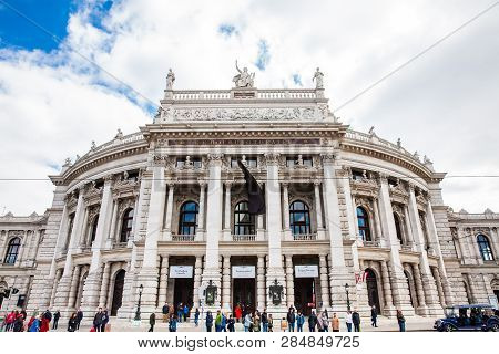 Vienna, Austria - April, 2018: Tourists At The Burgtheater In A Cold Early Spring Day