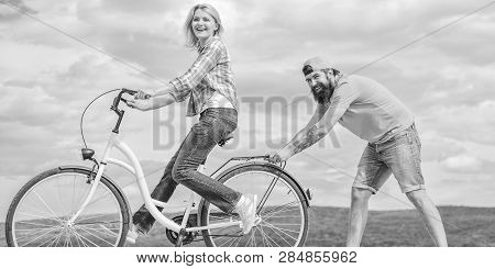 Teach Adult To Ride Bike. Find Balance. Woman Rides Bicycle Sky Background. How To Learn To Ride Bik