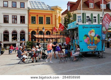 Ystad, Sweden - June 26, 2018: People Visiting An Mobile Ice Cream Kiosk Selling The Ottoglass Brand