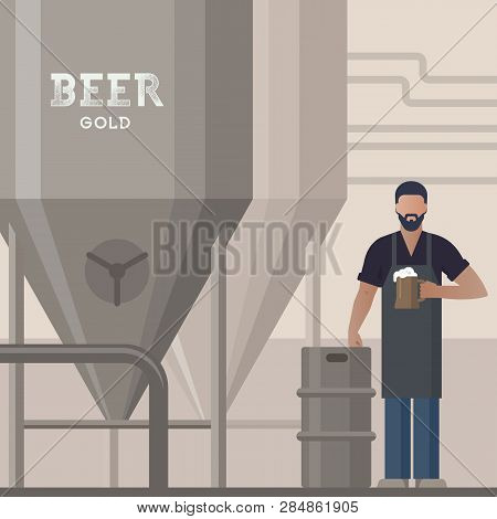 Brewer In Own Brewery With A Beer In The Hand Demonstrating Beer Production Near Barrels And Plant E