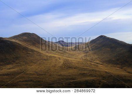Truffle Autumn Mountains And Heavy Leaden Sky