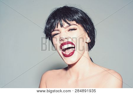 Woman With Attractive Red Lips Looks At Camera. Girl On Scandalous Shouting Face Posing With Naked S