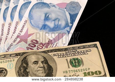 100 Turkish Lira And 100 Usd Banknote, Black Background, Side By Side,