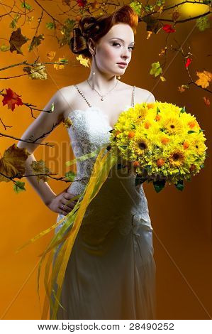 Beautiful Redhead Bride With A Bouquet Of Flowers