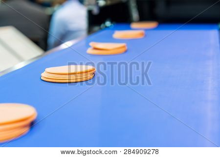Close up sliced bologna on automatic conveyor machine of industrial food manufacture poster