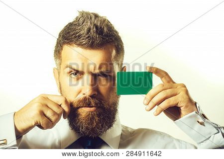 Banking Service. Confident Business Man Showing Credit Card. Handsome Man In White Shirt With Green