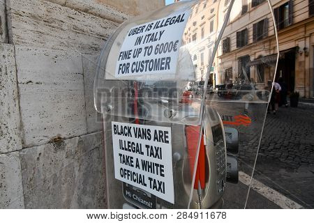 Rome, Italy - September 30 2018: A Sign Near A Taxi Station Prohibiting The Use Of Uber In The Histo