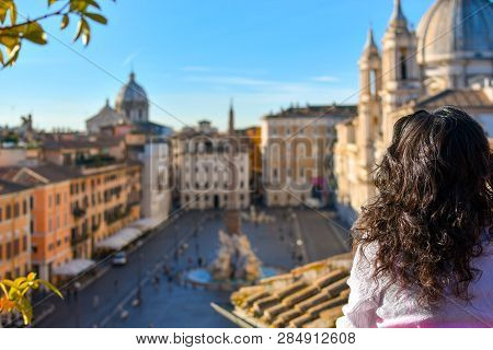 A Young Woman Gazes Out Over The Piazza Navona From A Rooftop Terrace On A Summer Morning In The His