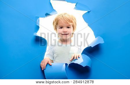 Small Boy Looking Through Paper Hole. Cute Child Peeping Through Hole In Paper. Little Kid Peeks Thr