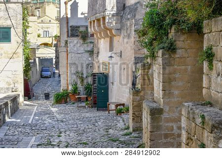 Matera, Italy - September 28 2018: A Stray Tabby Cat Stands On His Back Legs As He Prepares To Jump