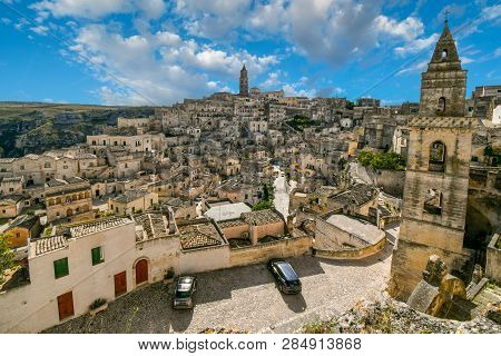 Matera, Italy - September 28 2018: View Of The Sasso Barisano, Tower, Old Town, Sassi Caves And Tour